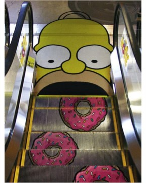 16) Homer eating donuts for The Simpsons movie launch