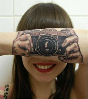 Fake out camera tattoo, nice idea. I wonder if anyone has stole the idea and updated it to a smart phone?