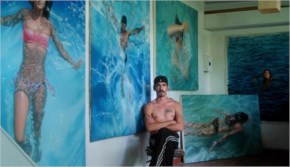 Gustavo Silva Nuñez surrounded by his work
