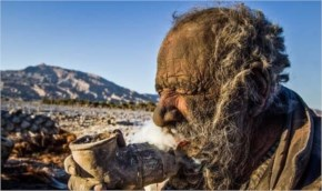 The 80 year-old leads a fairly primitive life, with his most prized possession being a steel pipe… that he smokes animal dung