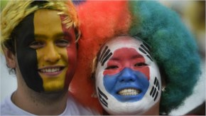A Belgian and a South Korean fan pose prior to a Group H football match between South Korea and Belgium at the Corinthians Arena in Sao Paulo during the 2014 FIFA World Cup.