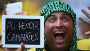 A Brazil fan displays a message to Cameroon prior to the 2014 FIFA World Cup Brazil Group A match between Cameroon and Brazil.