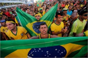 A Brazilian fan gestures as he watches the 2014 soccer World Cup soccer game between Brazil and Croatia at a Fan Fest complex in Fortaleza, Brazil