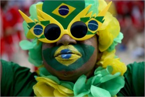 A Brazilian Soccer Fan Waits For The Team To Take The Field Against Cameroon At The FIFA Fan Fest On Copacabana Beach, Brazil