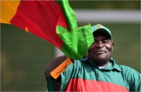 A Cameroon fan waves his national flag during Cameroon's training session at the Kleber Andrade stadium in Vitoria 2014 FIFA football World Cup in Brazil