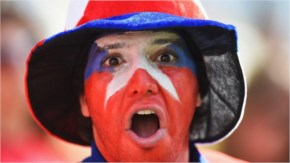 A Chile fan enjoys the atmosphere prior to the 2014 FIFA World Cup Brazil