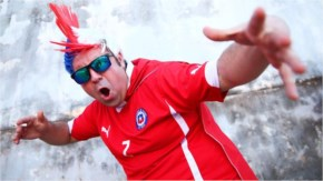 A Chile fan in a strange headpiece addresses the camera prior to the 2014 FIFA World Cup Brazil