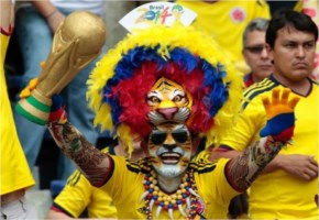 A Colombian Fan Cheers For His Team During Their Match Against Greece