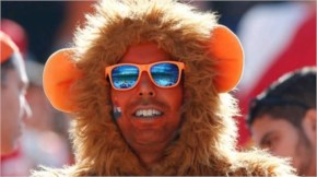 A Dutch fan waits for the beginning of the group B World Cup soccer