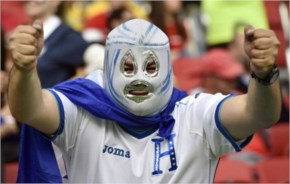A fan from Honduras shows off his outfit before the Group E World Cup soccer match between France and Honduras at the Estadio Beira-Rio in Porto Alegre, Brazil