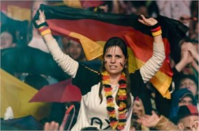 A fan holds a German flag as she watches the the FIFA World Cup 2014