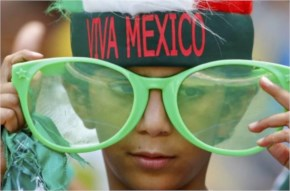 A fan of Mexico waits for the start of the 2014 World Cup