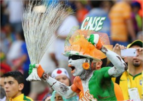 A fan of the Ivory Coast cheers in the crowd during the 2014 FIFA World Cup Brazil