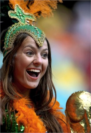 A fan of the netherlands holds a replica of the world cup before the world cup quarterfinal soccer match between the netherlands and costa rica