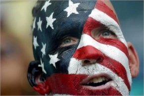 A fan of the United States with a painted face enjoys the atmosphere prior to the 2014 FIFA World Cup Brazil