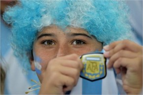 A fan showing the emblem of Argentina