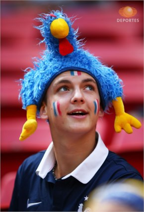 A France fan enjoys the atmosphere prior to the 2014 FIFA World Cup Brazil