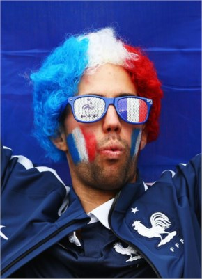 A France fan enjoys the the atmosphere prior to the 2014 FIFA World Cup Brazil