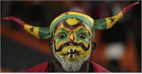 A Ghana fan is seen before a 2010 World Cup Group D soccer match against Germany at Soccer City stadium in Johannesburg