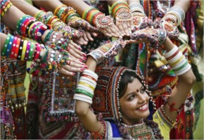 A girl dressed in traditional attire poses as she takes part in rehearsals for garba dance