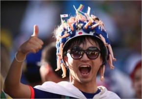 A Japan fan poses during the 2014 FIFA World Cup Brazil