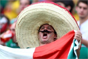 A Mexico Fan Cheers During The 2014 FIFA World Cup Brazil