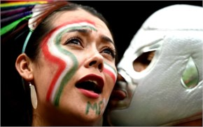 A Mexico fan receives a kiss during the 2014 FIFA World Cup Brazil