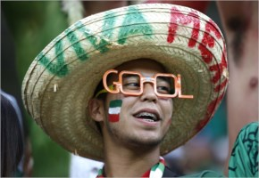 A Mexico fan waits for the start of the group A World Cup soccer match between Croatia and Mexico