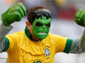 A representational picture of a Brazil soccer fan wearing a Hulk mask, cheers before the start of his team's World Cup round of 16 soccer match with Chile at Mineirao Stadium in Belo Horizonte, Brazil