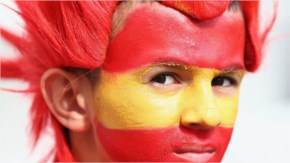 A young Spain fan looks on prior to the 2014 FIFA World Cup Brazil