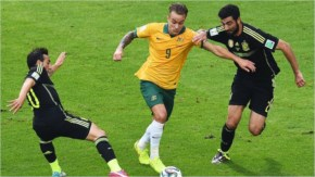 Adam Taggart of Australia is challenged by Santi Cazorla, at left, and Raul Albiol of Spain during the 2014 FIFA World Cup Brazil