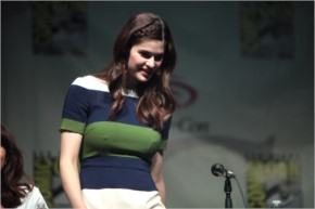 Alexandra Daddario - Something is fashing our from tight t-shirt