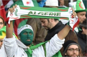 Algeria's fans cheer Germany and Algeria at Beira-Rio Stadium in Porto Alegre during the 2014 FIFA World Cup
