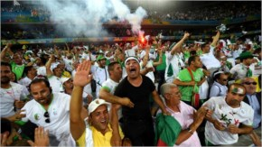 Algeria fans celebrate after their first goal during the 2014 FIFA World Cup Brazil Group H match between Algeria and Russia at Arena da Baixada