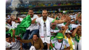 Algeria fans celebrate their team qualifying for the knock out stage after the 1-1 draw in the 2014 FIFA World Cup Brazil