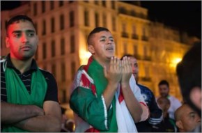 Algeria football fans react as they watch the 2014 FIFA World Cup Algeria and Germany