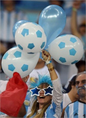 An Argentinian fan waves balloons as she cheers before a Group F football match between Argentina and BosniaHercegovina at the Maracana