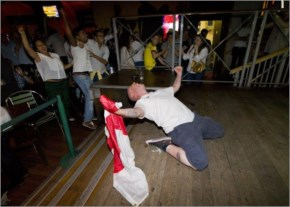 An England supporter reacts in the Walkabout bar in central London, after England scored an equalizing goal during their first Group D match against Italy in the 2014 FIFA World Cup in Brazil
