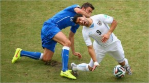 Andrea Barzagli Of Italy Challenges Luis Suarez Of Uruguay During The 2014 FIFA World Cup Brazil