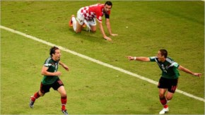 Andres Guardado of Mexico, on the far left, celebrates scoring his team's second goal during the 2014 FIFA World Cup Brazil