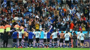 Argentina acknowledge the fans after defeating the Netherlands in a penalty shootout during the 2014 FIFA World Cup Brazil