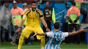 Argentina's midfielder Maxi Rodriguez (front) and Argentina's goalkeeper Sergio Romero celebrate after winning their FIFA World Cup semi-final