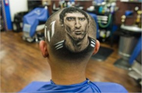 Argentine soccer player Lionel Messi is cut onto the head of a customer ahead of tomorrow's World Cup