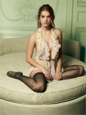 Barbara Palvin has no idea how to sit in that huge chair either