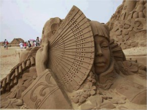 Beautiful Large Sand Sculpture Of Woman With Fan