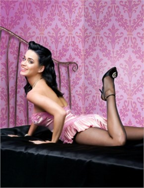 Bold and beautiful Katy Perry lying on bed