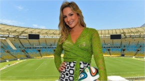 Brazilian singer Claudia Leitte displays one of the authors of the 2014 World Cup theme song poses during the 2014 FIFA World Cup Host City Tour at Maracana