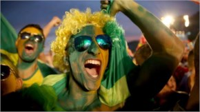 Brazilian soccer fans react to their team scoring a second goal against Cameroon while watching on a screen at the FIFA Fan Fest on Copacabana beach in Rio de Janeiro, Brazil.