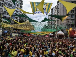 Brazil's fans react during a public viewing event at a street in Rio de Janeiro during the 2014 FIFA World Cup semifinal match Brazil vs Germany --being held at Mineirao Stadium in Belo Horizonte