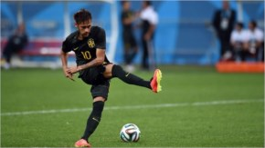 Brazil's forward Neymar kicks a ball during a training session in FIFA 2014